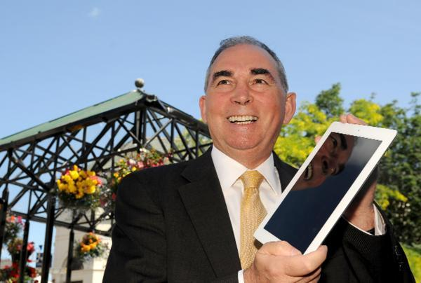 Giles Archibald – with his tablet –  looks forward to the planned new free WiFi zone across Kendal town centre