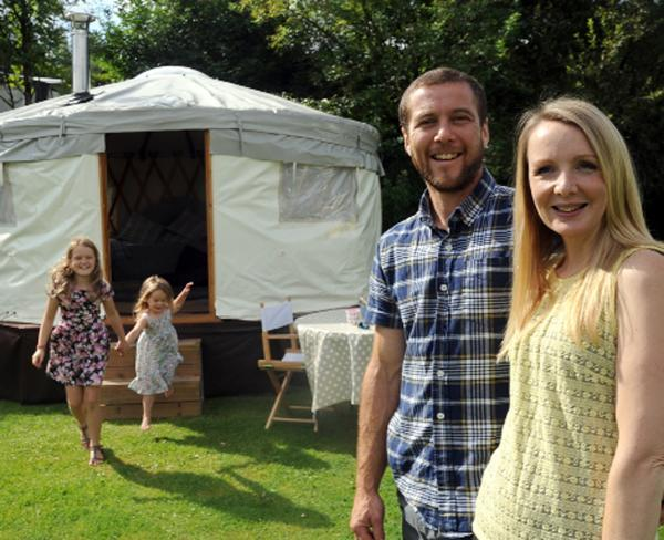 Hamish and Michelle Fullerton show off the 'Go Yurt' with children Georgia and Frankie