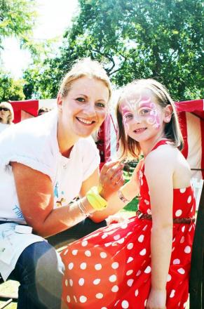 FLOWER POWER: Jo Ward demonstrates her face painting skills