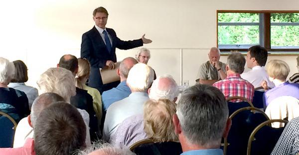 Lunesdale MP David Morris addresses a residents meeting concerning the homes plan