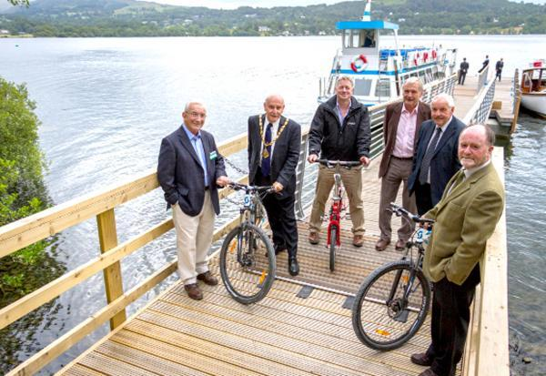 Celebrating the new 'Bike Boat' jetty on Windermere are, left to right, David Thornton, Coun Geoff Cook, Richard Greenwood, Mike McKinley, Coun Keith Little and Bill Bewley