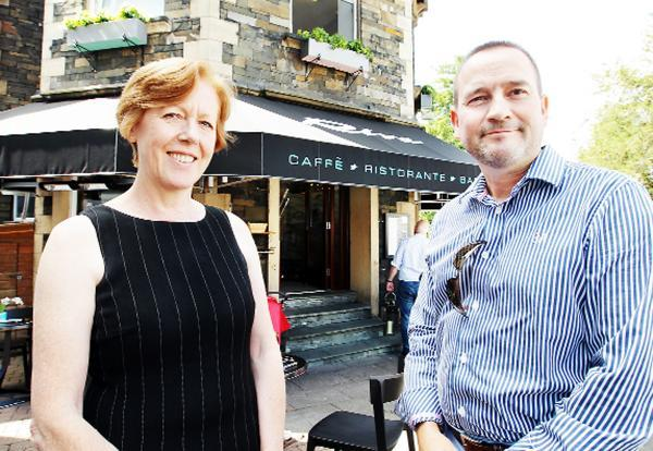 Colin Monk outside Caffe Riva with Naomi Fell, a director at Harri