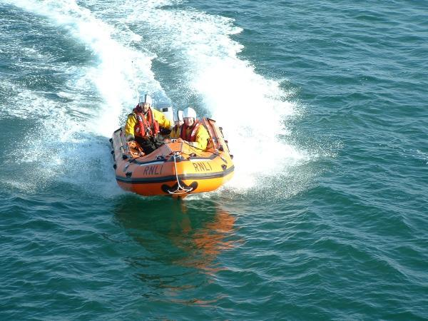 Lifeboat crews rescue group unable to start their dinghy's engine