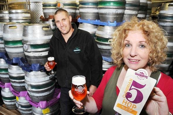 head brewer Matt Clarke and sales manager Anne Jones try a taste of their Cumbrian Five Hop beer