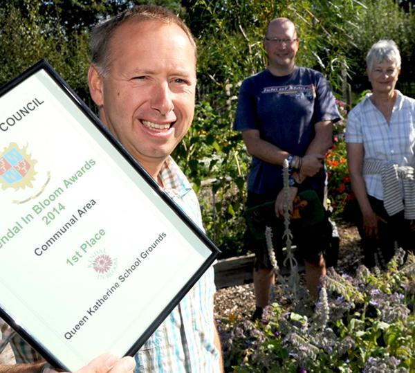 Queen Katherine School headteacher Gareth Roscoe with the school's Kendal in Bloom award with plot holder Ian Parker and volunteer Heather Fielding