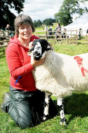 Wendy Dickinson with her first prize Gimmer lamb