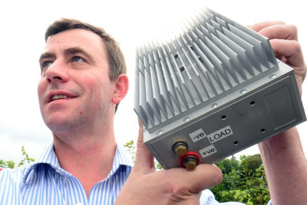 Simon Patterson of MSP Technologies shows off his new lightweight hybrid power generator