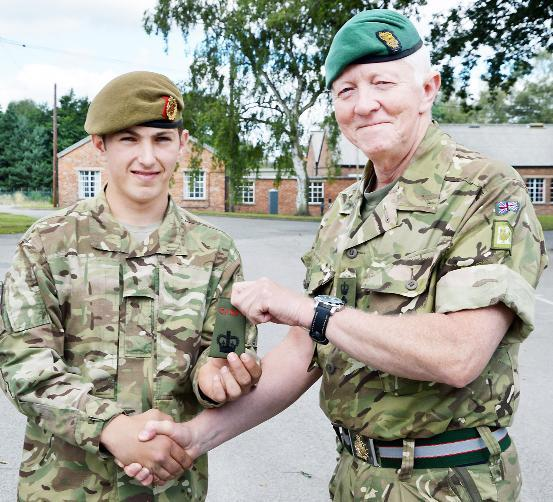 Callum Dobson who has achieved the rank of Cadet Sergeant Major, with Col Tom McMullen, commandant of Cumbria ACF