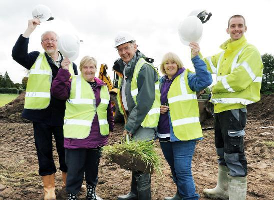 At the site of the new hall are from left, Building Village Hall Committee trustee Glenda Burton, chairman Ray Broomby, trustees Les Baines and Joyce Keetley, and Graham Bland of Cox & Allen builders
