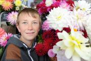 BLOOMIN MARVELLOUS. Cody Smith, 13yrs old from Milnthorpe, has been selling his homegrown flowers and arrangements outside Booths supermarket in Milnthorpe over the summer. (11129175)