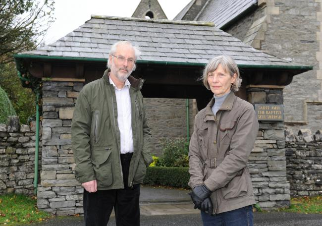 SKELSMERGH WW1 HERITAGE LOTTERY GRANT.  Pictured are Tony Cousins, Parish Historian, and Helen Atkinson, Church Warden beside the lychgate of the Church of St. John the Baptist, Skelsmergh - the church council has been awarded £5900 from the Heritag