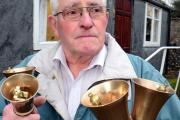 DISHARMONY: One of Silverdale Handbell Ringers, Jim Bolton, outside their hut in the grounds of Silverdale Institute.
