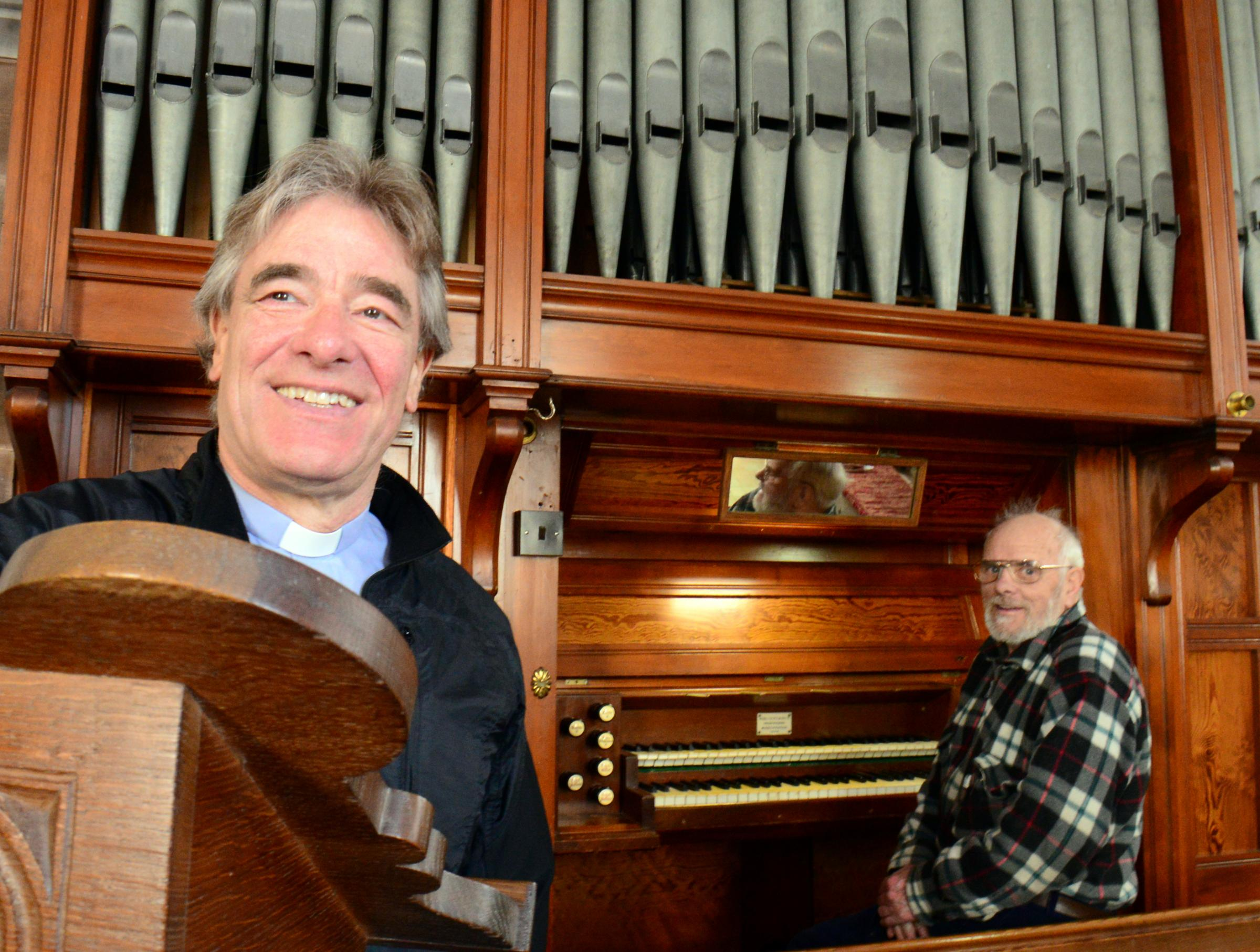 (left) Vicar Tim Harmer at St Luke's Church, Torver with Roger Mallinson who restored the church organ. (23803231)