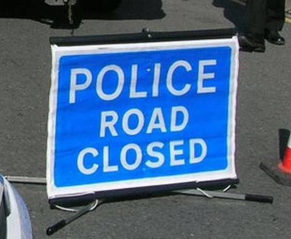 Road closed in both directions after crash between a car and lorry