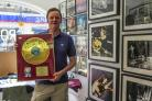 Brian Cannon shows off the golden disc signed by Noel Gallagher of Oasis