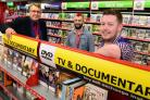 (left), Mayor Chris Hogg opens CEX pictures with Acting Store Managers Richard Whitley and Stephen Hall. (36118474)