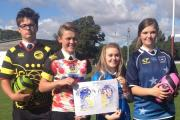 DELIGHTED: Children from Ulverston Victoria High look happy with their designs