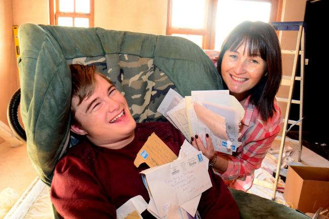Robbie Young and mum Heather smile after Gazette readers raise more than £11,000