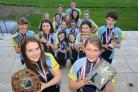 Children from Ulverston Victoria High School have won 6 awards at The British Schools Orienteering championships. Pictured (front) is Megan Bartlett and Lizzie Hampshire with a small selection of the winning teams.. (46670564)