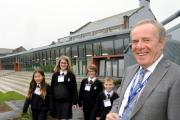 Ulverston Victoria High School officially opened its new £5m building at Ulverston Victoria High School. Chairman of Cumbria County Council Melvyn Worth cuts the ribbon with the youngest Year 7 students Kara Grace, Oliver Burrows, Dylan Webb and Eleano