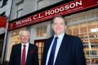 Colin Tomlinson (left) with Chief Executive of H&H group, Brian Richardson outside Kendal's Finkle Street branch