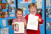 Two pupils from Giggleswick Junior School with the letter from The Queen. Picture by B.P.M. Harris Photography
