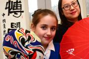 Chinese teacher Li Wenxuasn visits Leven Valley school with pupil Katie Oldcorn..