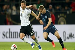Lukas Podolski finishes with a flourish as Germany defeat battling England