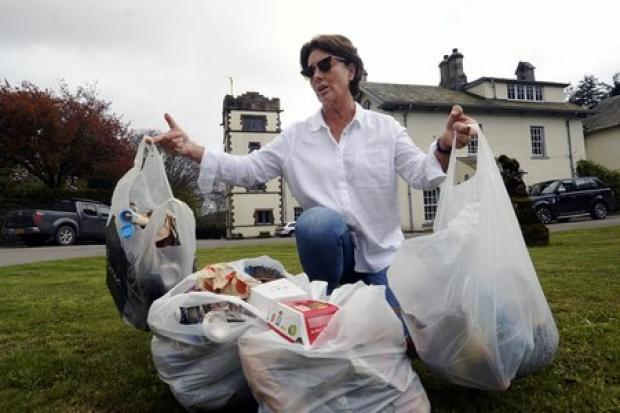 ANGRY: Camilla Sandys with rubbish she collected from her Graythwaite estate...JON GRANGER.