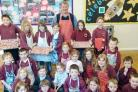 Dave Morland, the head of butchery at Westmorland Family Butchers at Tebay Services, with pupils at Crosby Ravensworth Primary School.