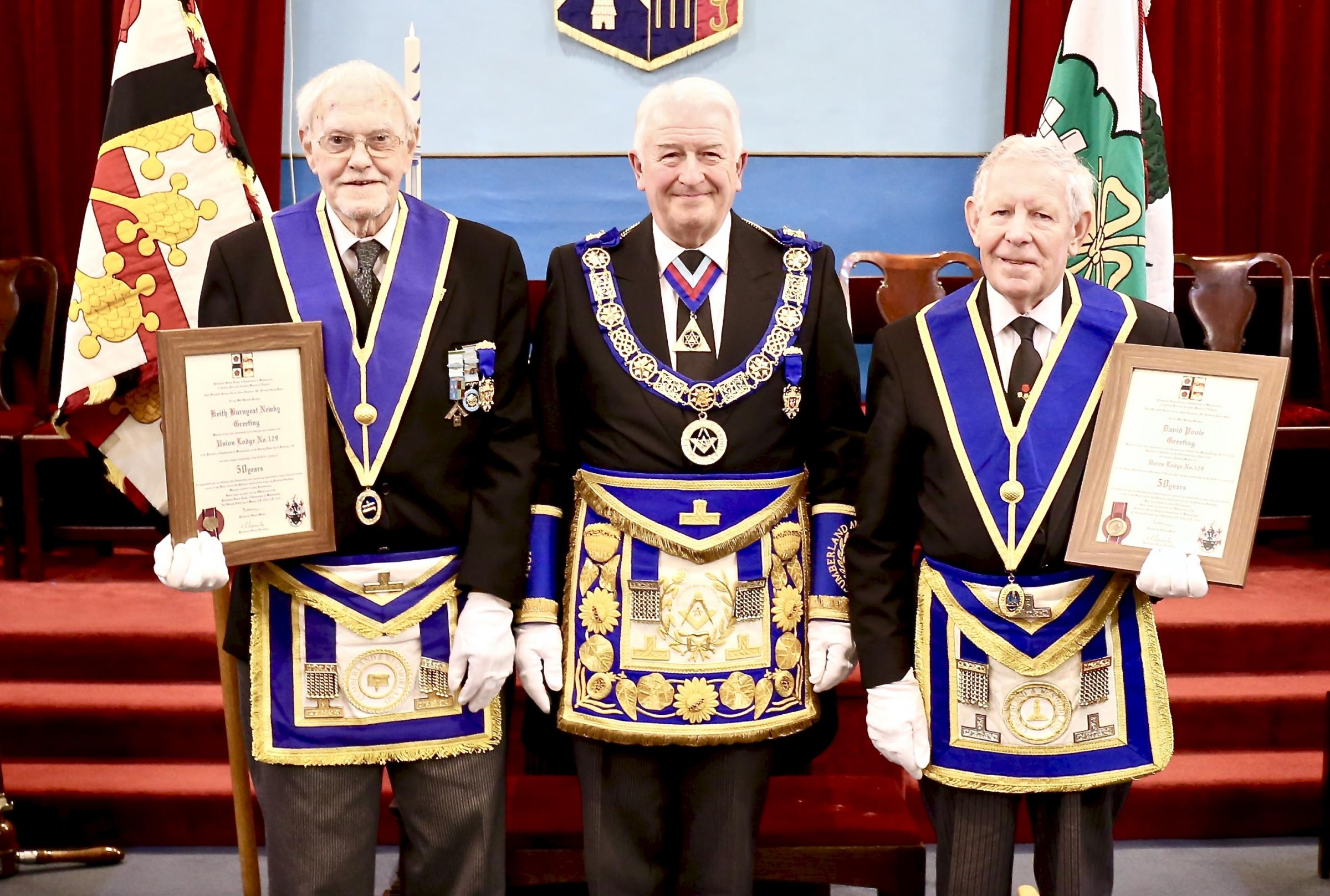 Celebrating their golden jubilee in Freemasonry are Keith Newby, left, and David Poole OBE, right, pictured with provincial grand master Norman Thompson (PICTURE: Brian Ferrington)