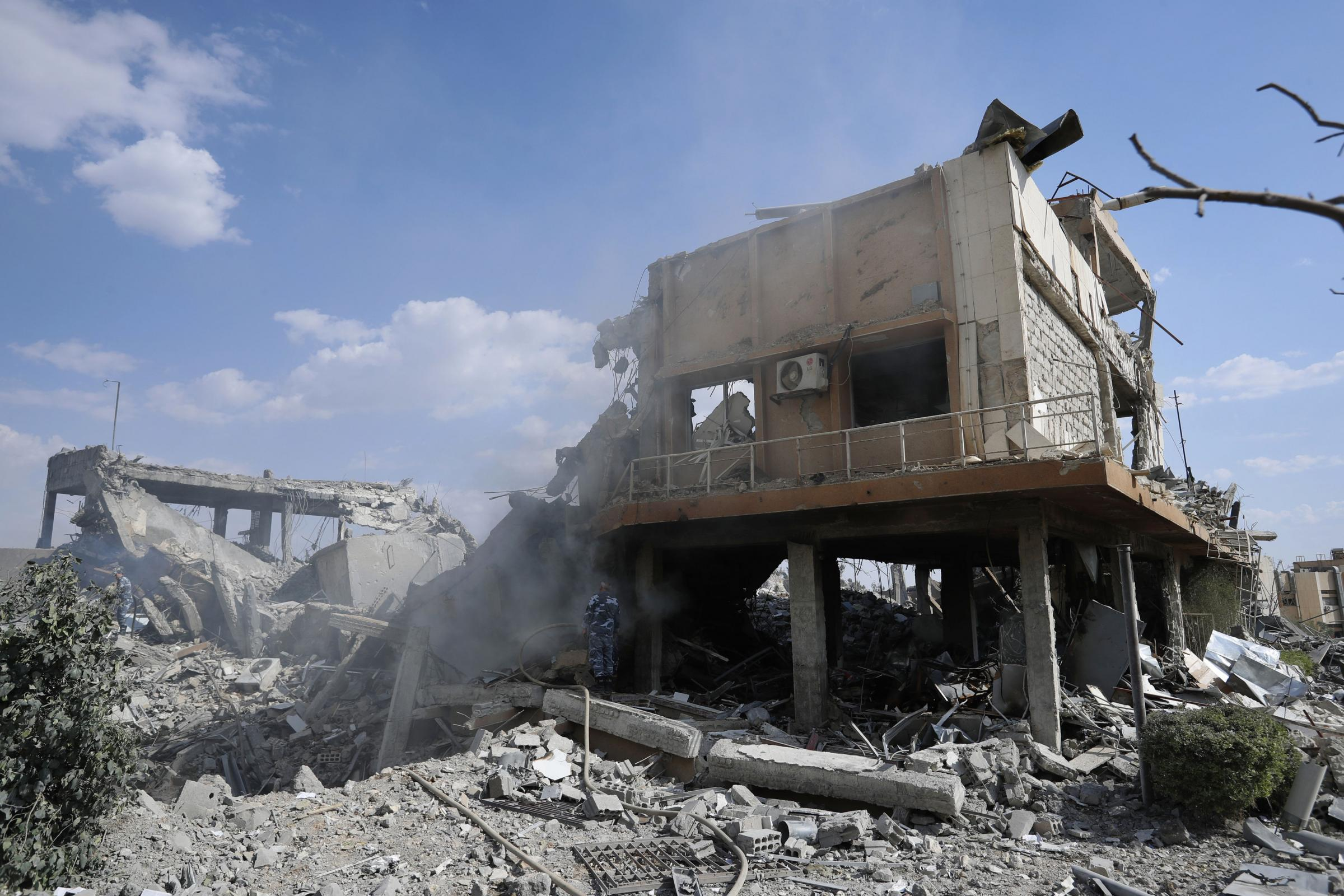 Damage at the Syrian Scientific Research Center which was attacked by U.S., British and French military strikes. (AP Photo/Hassan Ammar).