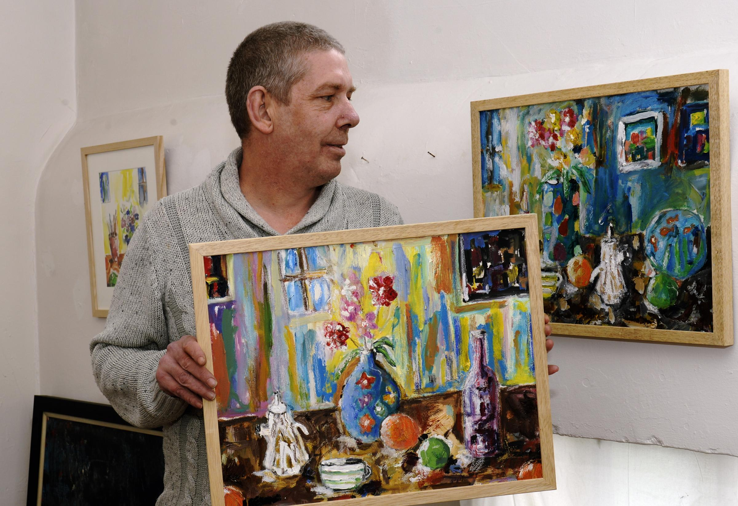 Ulverston artist Tim Leeson with some of the work in his retrospective exhibition Hiding From Myself, which runs at Kendal's Signature Gallery until May 19. Picture: JON GRANGER
