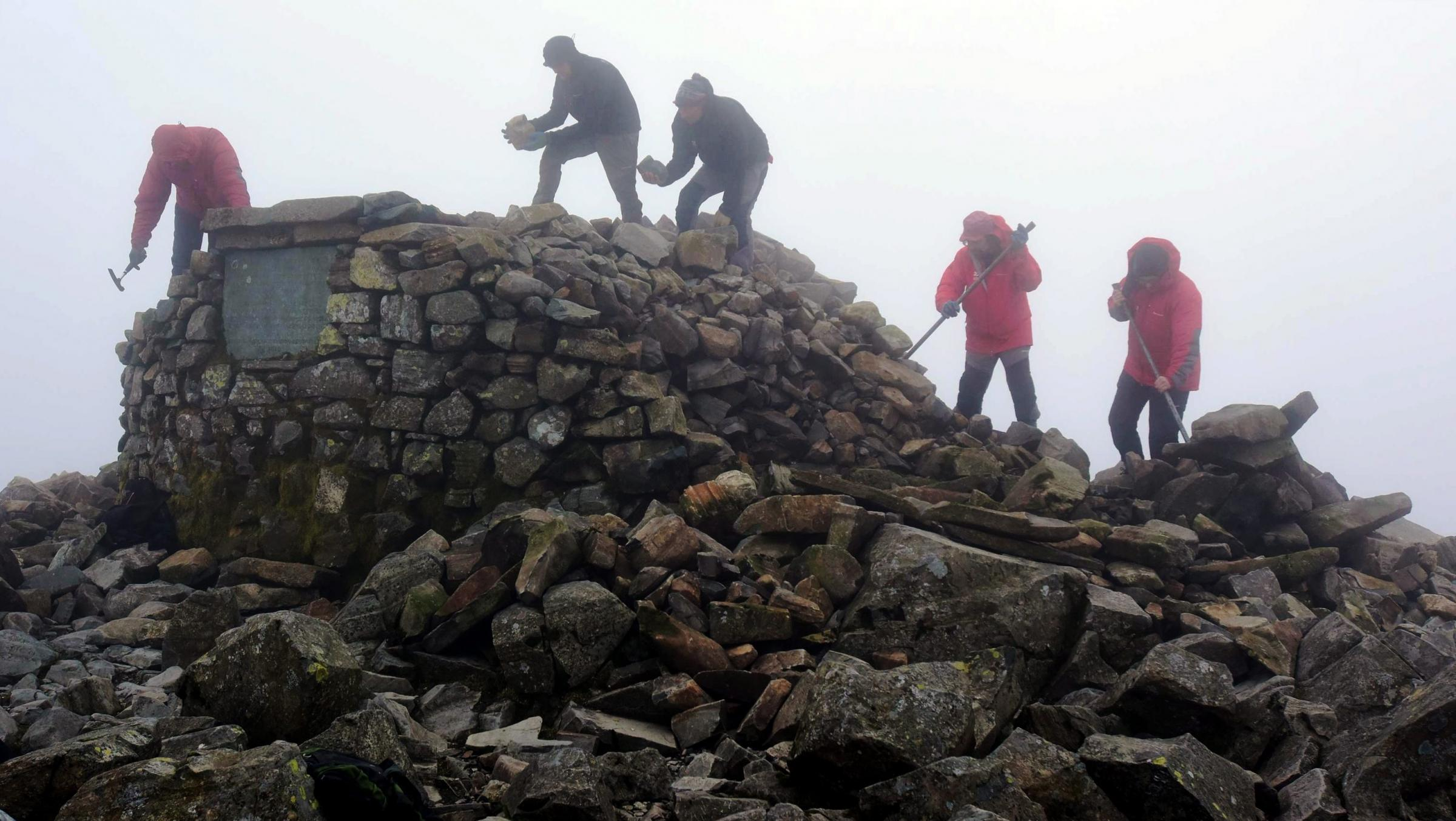 National Trust Rangers working on the cairn in 2018. C. Paul Kingston and National Trust