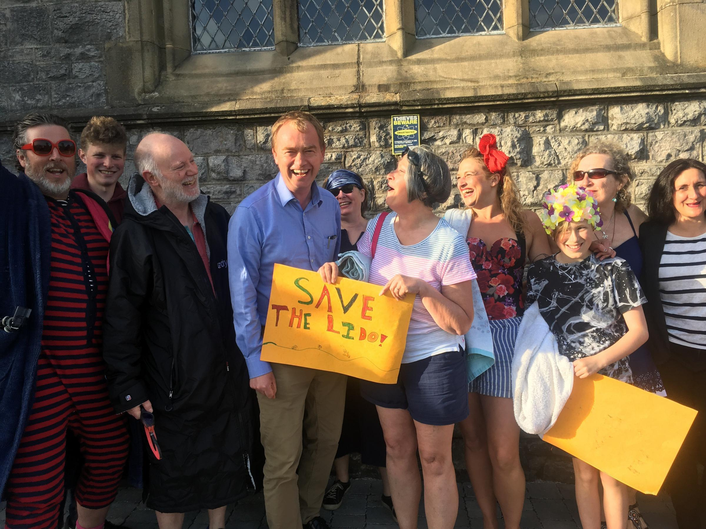 Tim Farron's surgery saw swimwear wearing supporters of a restored lido in the town