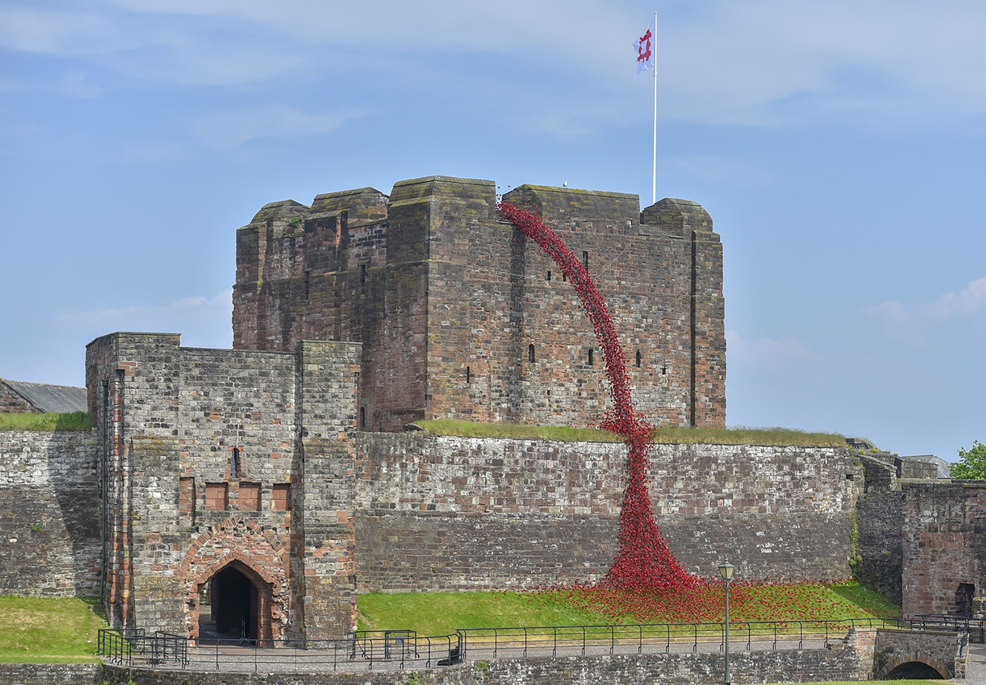 Poppies: Weeping Window at Carlisle Castle. The sculpture opens at Carlisle Castle to the public on 23rd May. The work by artist Paul Cummins (pictured left) and designer Tom Piper will form part of the final year of 14-18 NOW's UK-wide tour of the po