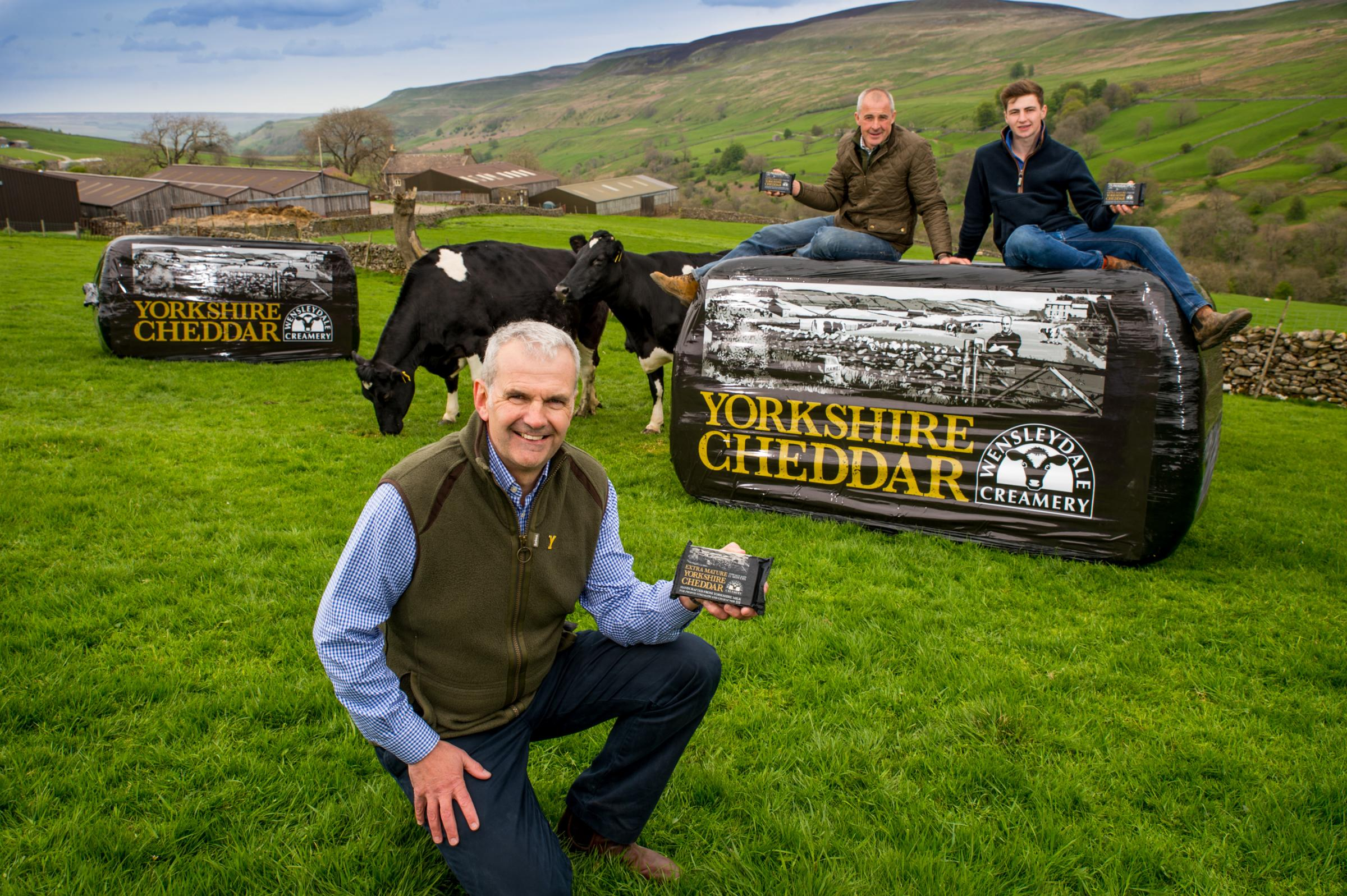 Wensleydale Creamery managing director David Hartley and Wensleydale dairy farmer Robert Tiplady and son. Picture: Simon Dewhurst