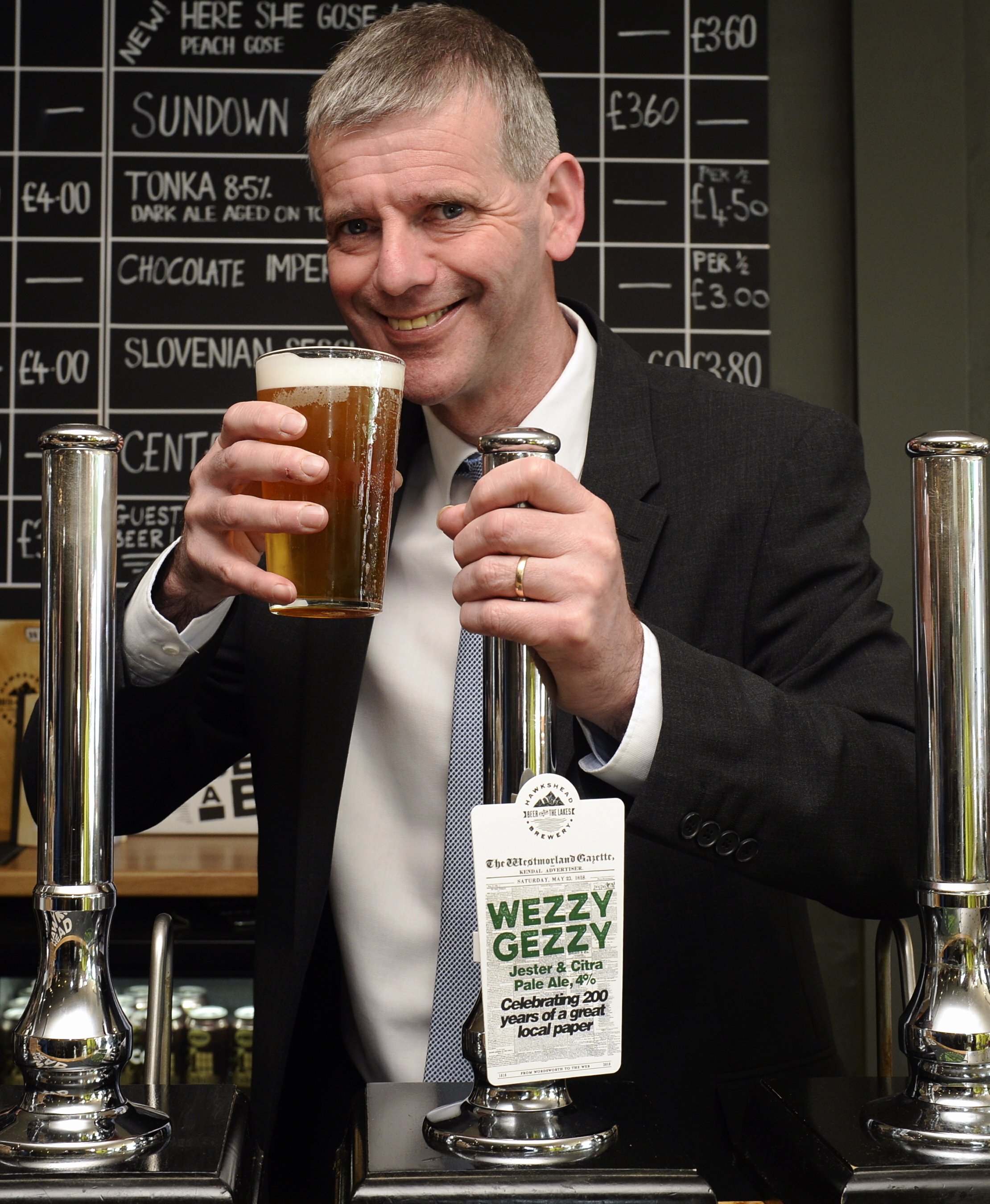 Westmorland Gazette editor Andrew Thomas after pulling the first pint of Wezzy Gezzy beer at Hawkshead Brewery in Staveley...04/04/2018..JON GRANGER.