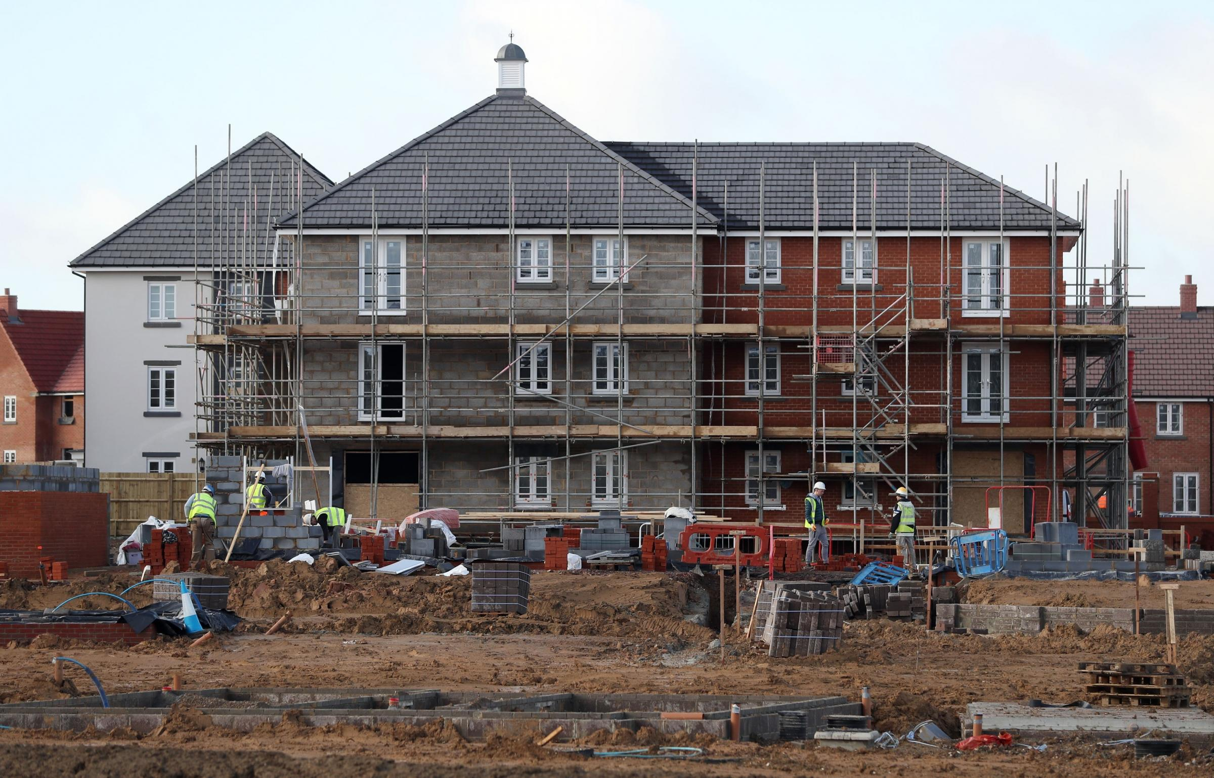 Houses under construction (Picture: Andrew Matthews/PA Wire)