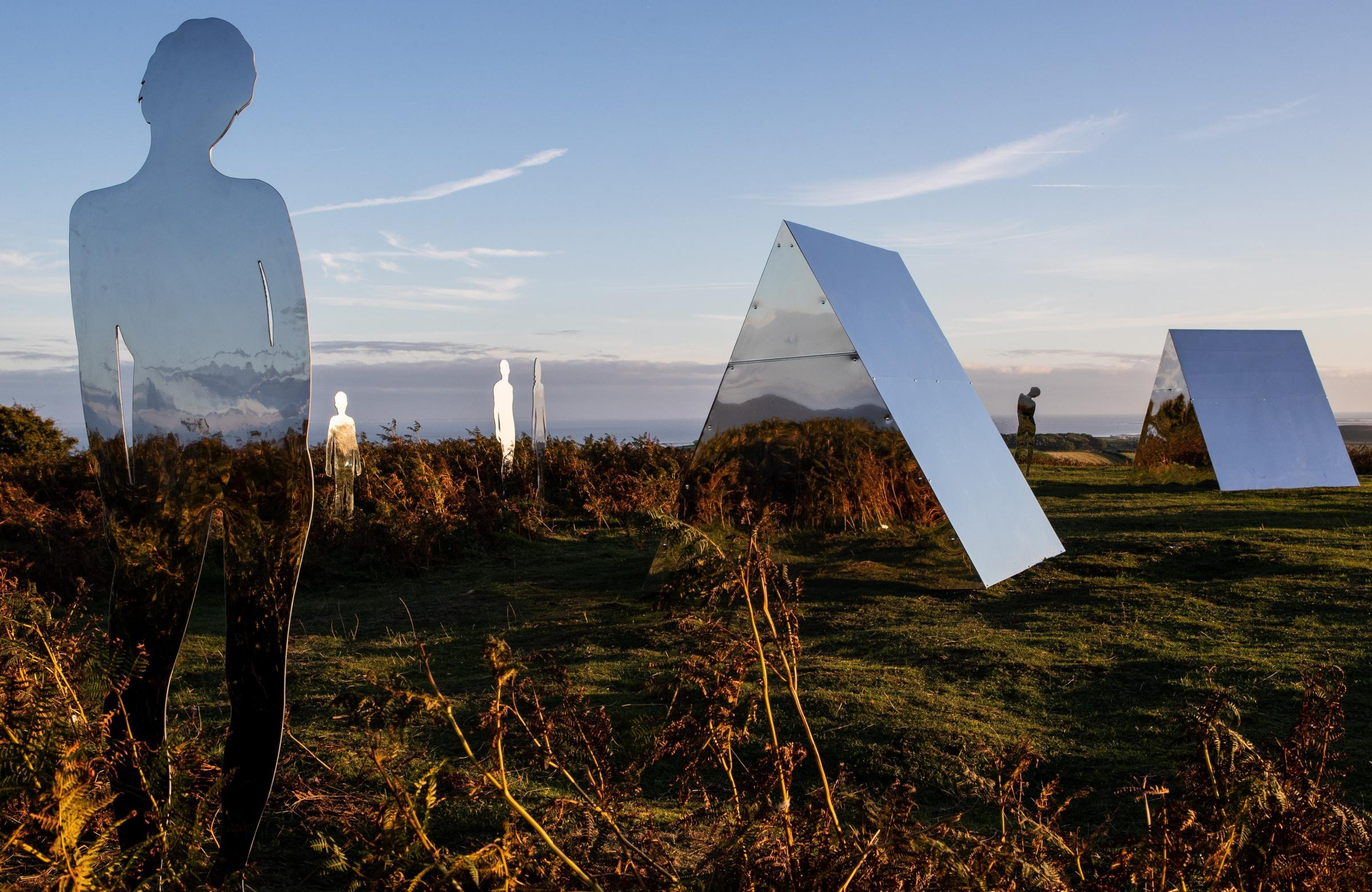 Mirrored figures and dwellings at Birkrigg Common. Picture: Miles Peacock