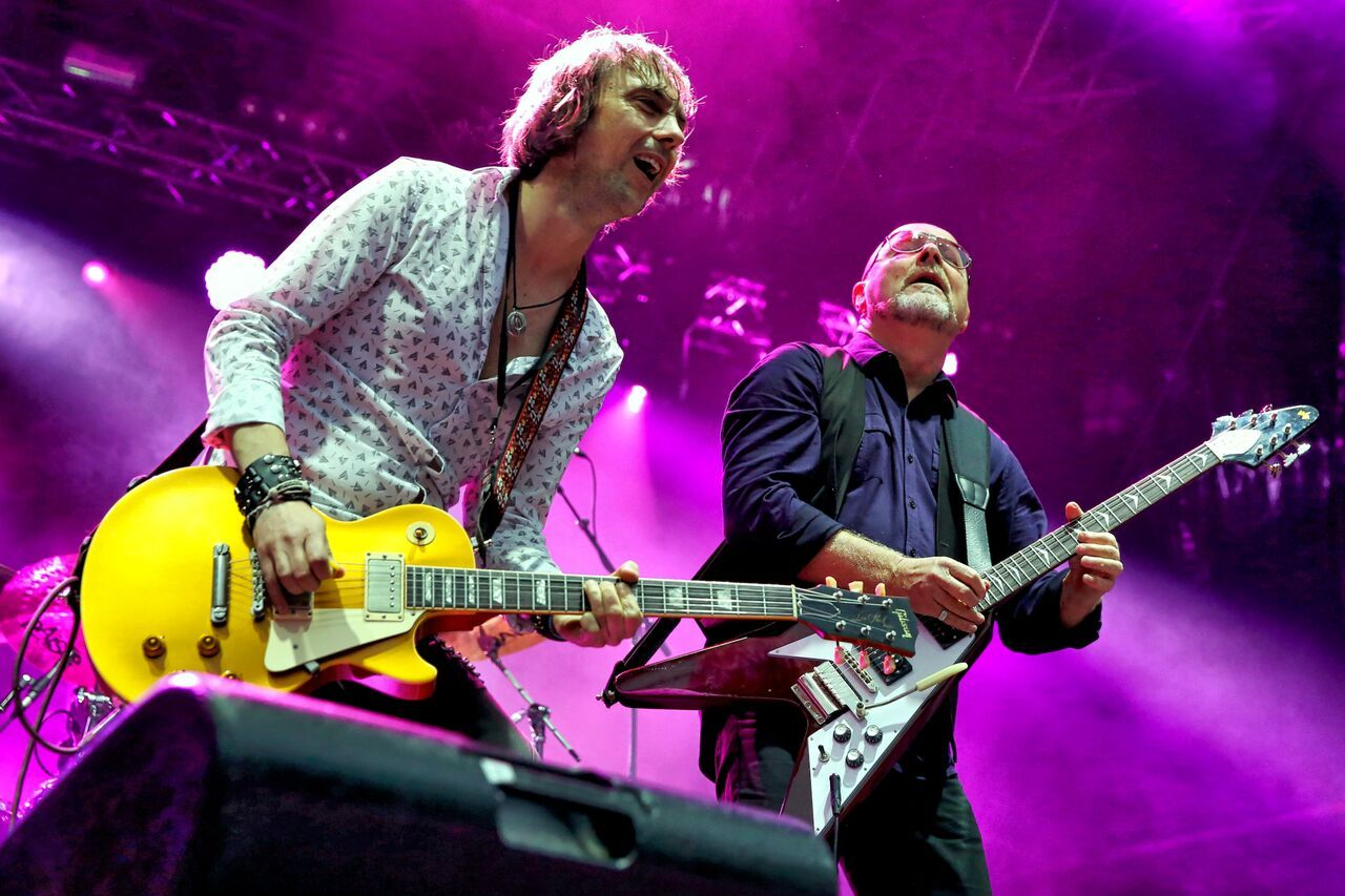 Wishbone Ash still includes founding member Andy Powell (on right), who handles lead vocals and trades licks with new guitar wizard Mark Abrahams (left)