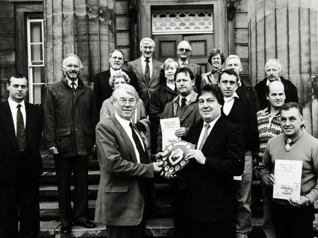 MP for Carlisle Eric Martlew presenting the Cumbria in Bloom Westmorland Gazette Shield, to chairman of the East Cumbria Health Health Committee Ian Carr in 1992