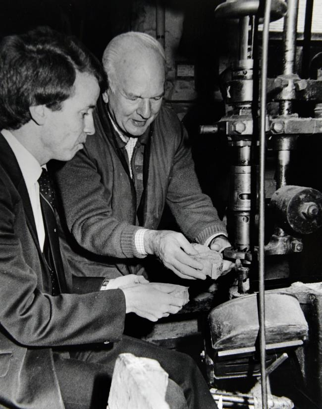 Secretary of State for the Environment Colin Moynihan (left) on a visit to Stott Park Bobbin Mill in 1987