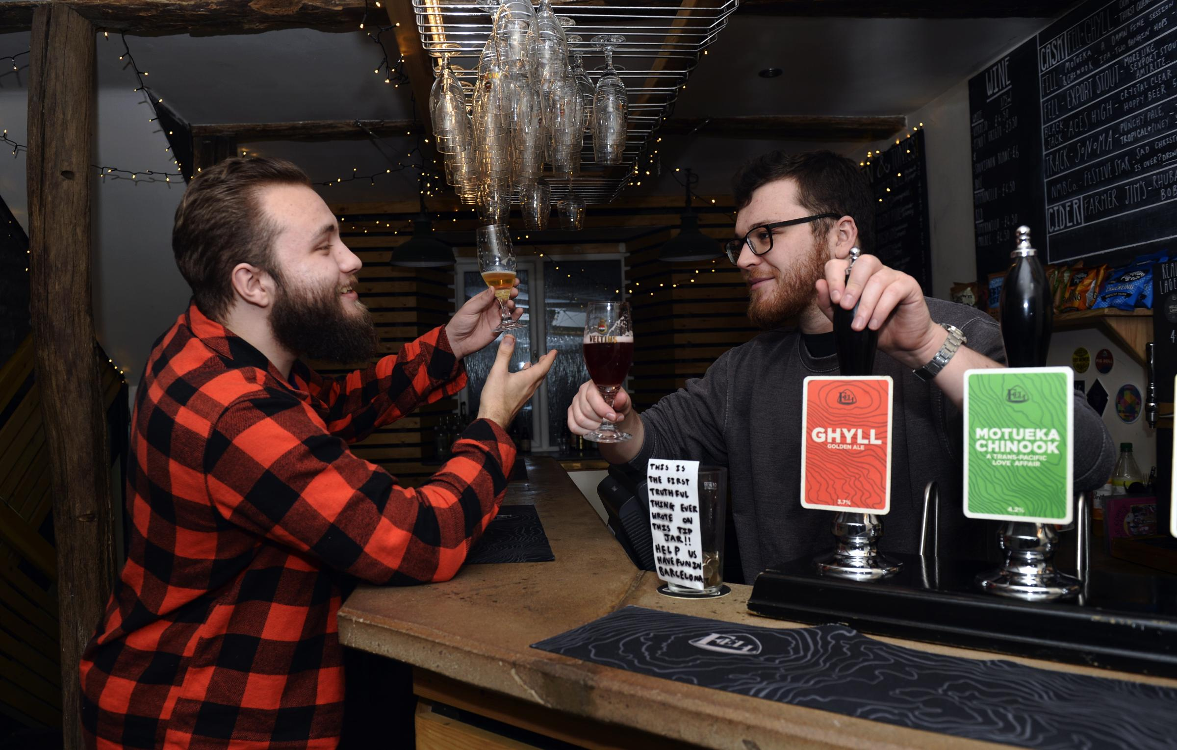 Ben Evans (right) of the Fell Bar in Kendal discussing craft beers with customer Charlie Gray...09/01/2019..JON GRANGER.