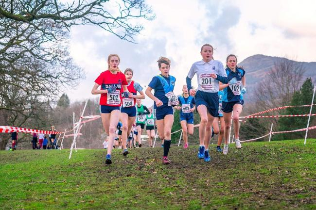 Rosie Woodhams, left, taking on male and female rivals during the recent Cumbrian cross country championships