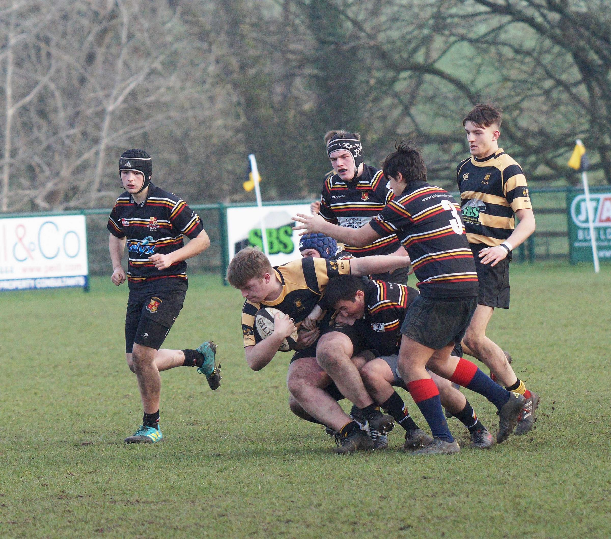On the charge... action from Kendal Under 17's cup win over Tarleton. Picture: RICHARD EDMONDSON