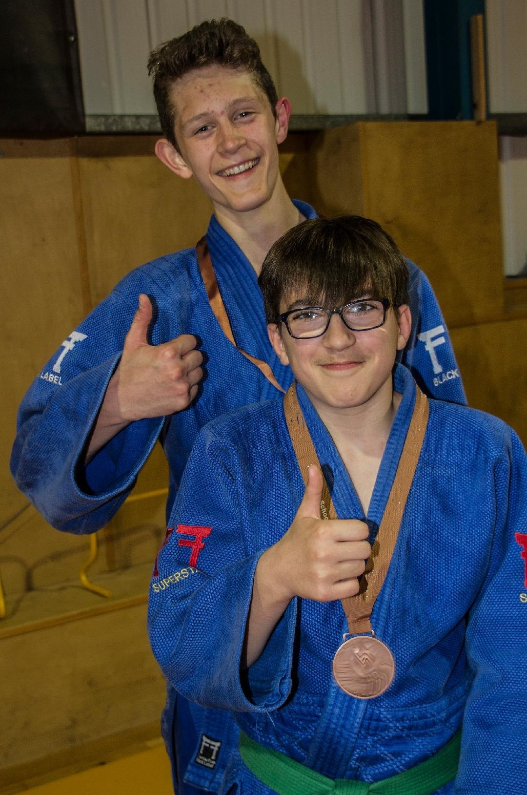 Nye Greasley, front, and Nathan O'Sullivan with their medals