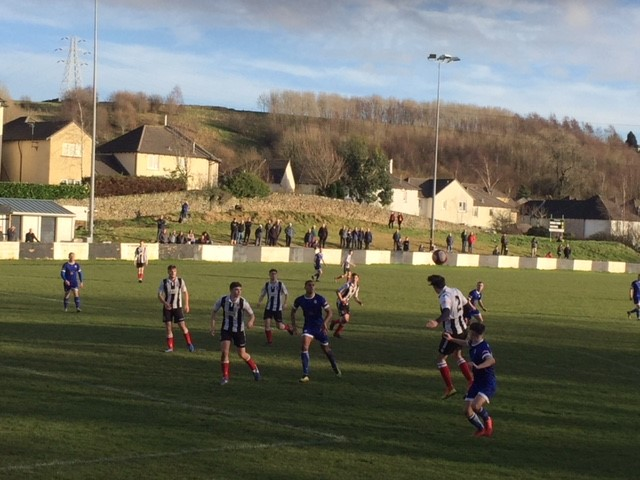 Action from Kendal Town's match against Glossop
