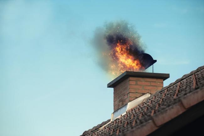 Chimney with fire coming out.