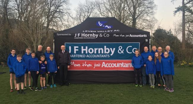 Members of Leven Valley AC with their new tent